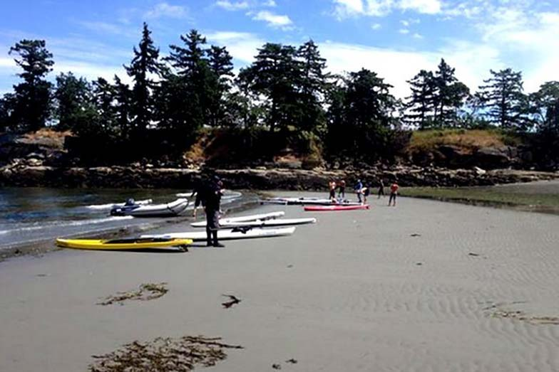 Stand Up For Men's Health paddle boarders rest and lunch at Dionisio Point