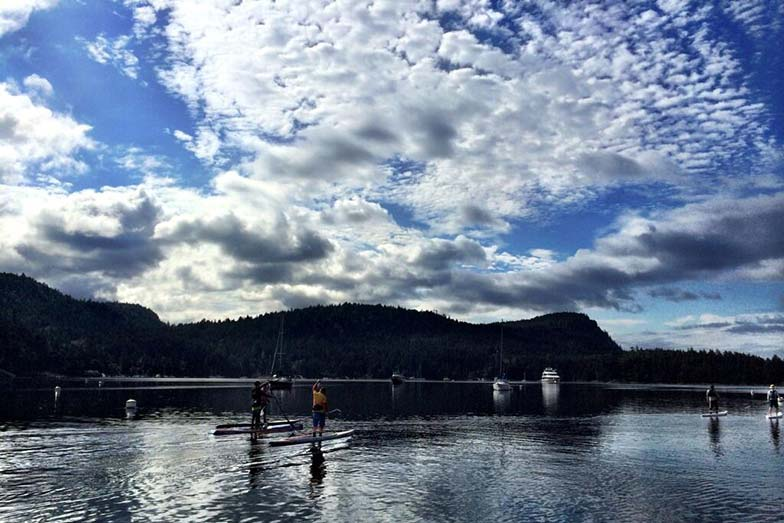 Stand Up For Men's Health paddle boarders between Galiano and Salt Spring Islands on Day 2