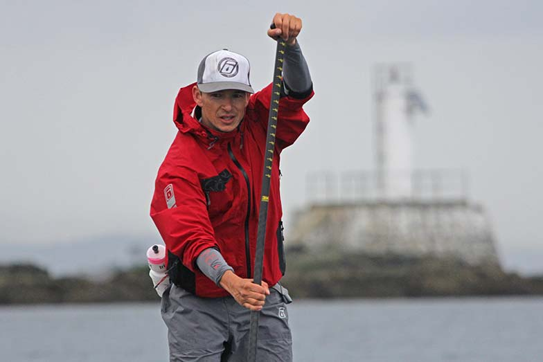 Simon Whitfield stand up paddle boarding
