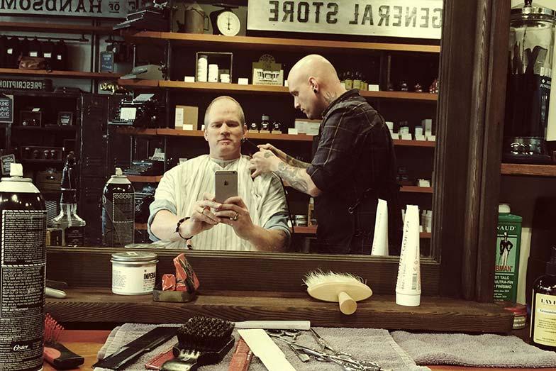 Adam Kreek at the barber